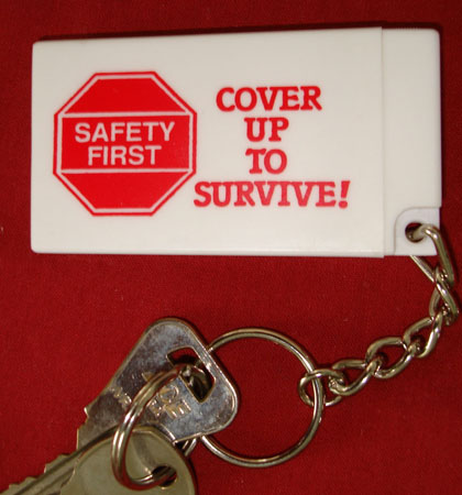 COVER UP TO SURVIVE! - Condom Key Chain